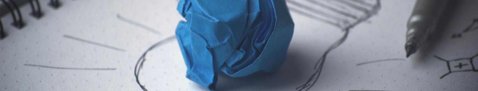 Hintergrundbild Papierball blau – Fachbereich Kinische Psychologie